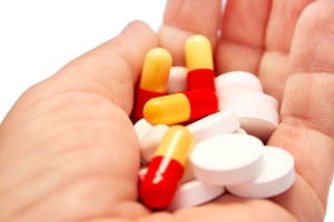 Medical pills and tablets on the hand.